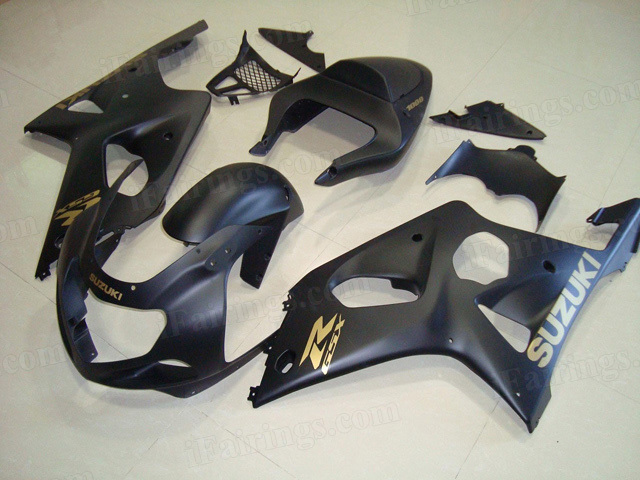 2000 2001 2002 Suzuki GSXR1000 matte black fairings with gold stickers.