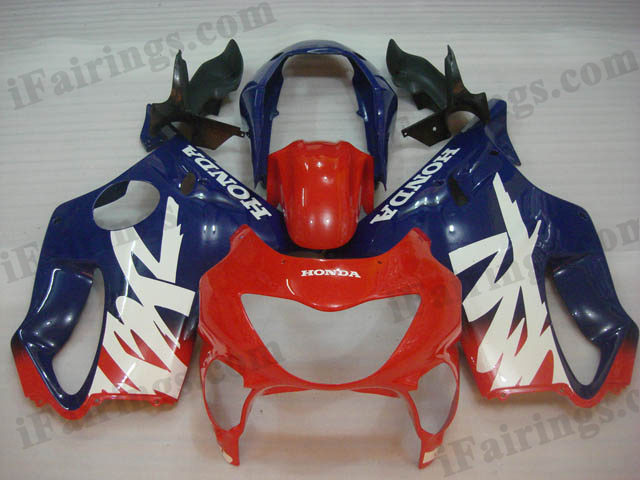 1999 2000 CBR600 F4 red and blue fairings.