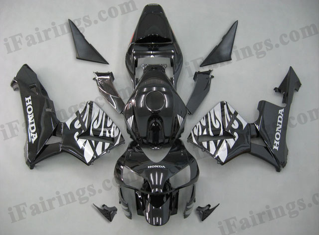 2003 2004 CBR600RR black and silver flame fairings.