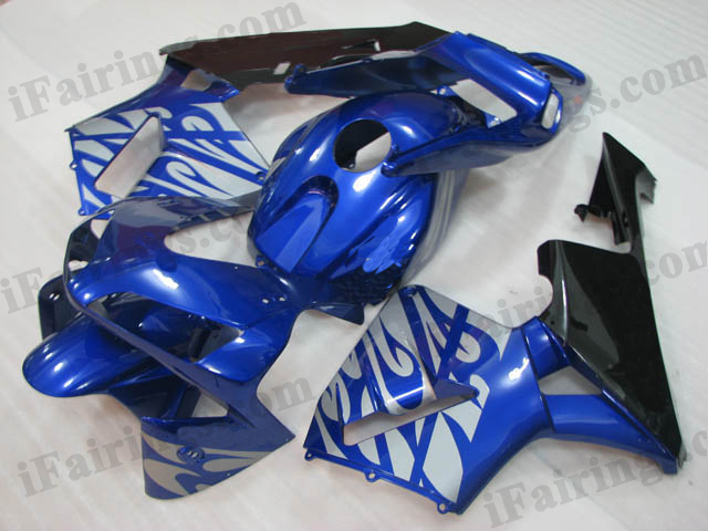 2003 2004 CBR600RR blue and black fairing with silver strips.
