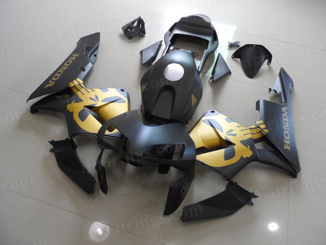 2003 2004 Honda CBR600RR matte black fairings with gold skull symbol.