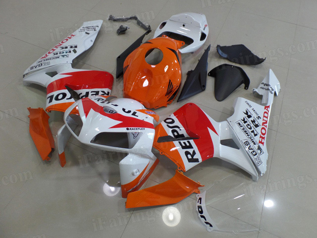 2005 2006 Honda CBR600RR orange and white repsol graphic fairings.