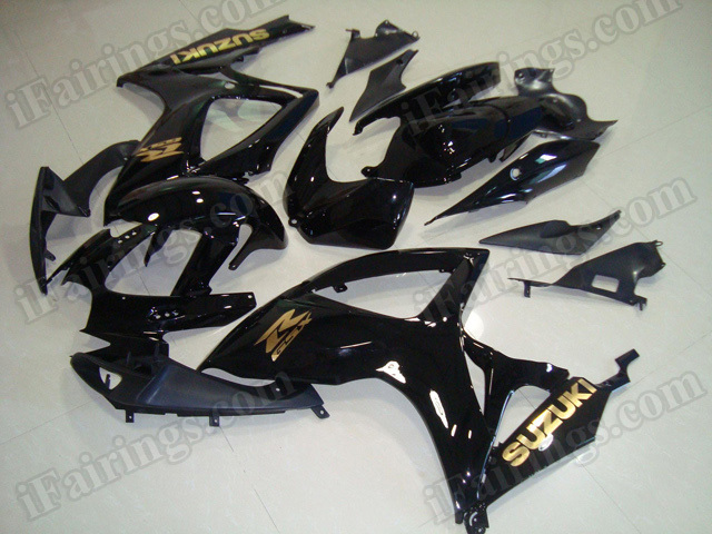 Motorcycle fairings/bodywork for 2006 2007 Suzuki GSX R 600/750 black with gold stickers.